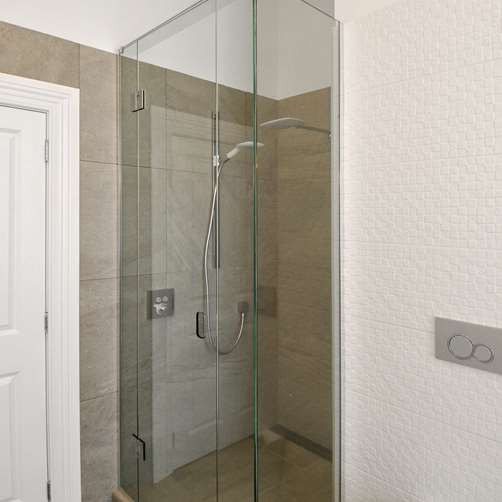 Glass Screen uneven walls Shower in bathroom by Metro Glass
