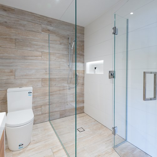 Metro Performance Glass  corner shower with a hinged door and chrome square D handle.jpg