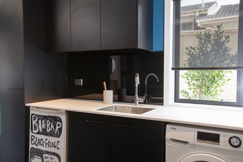 Metro Performance Glass laundry glass splashback.jpg